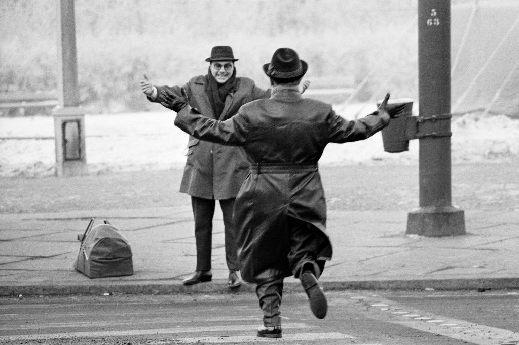 Two Brothers reuniting after West Berliners were allowed to cross the East Berlin.