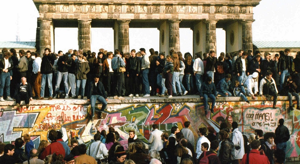 People gathering in front of the Berlin Wall