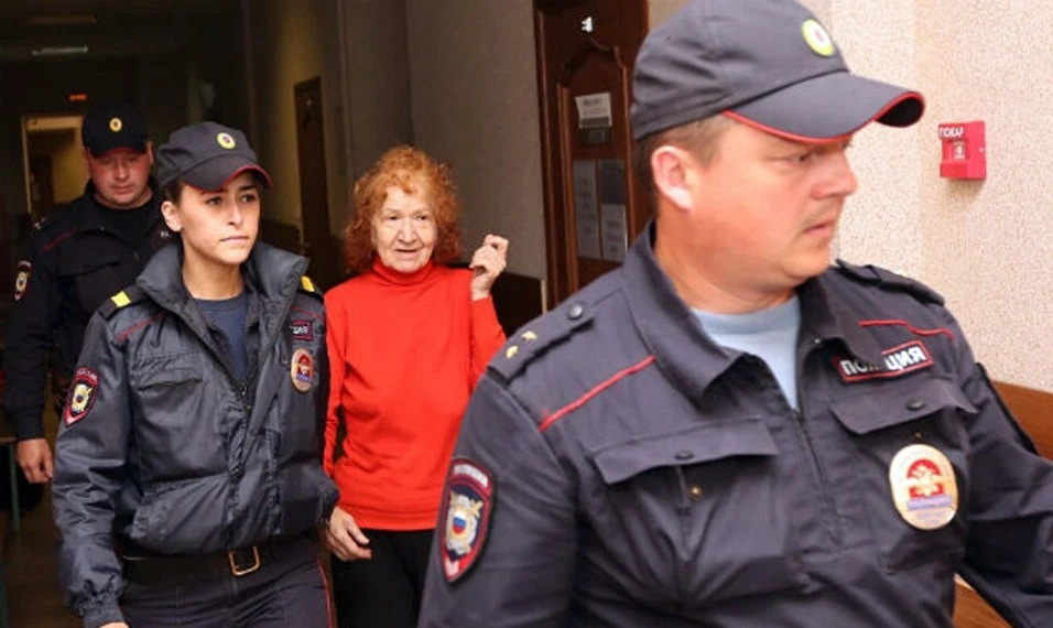 Ripper Granny is escorted by guards to the courtroom