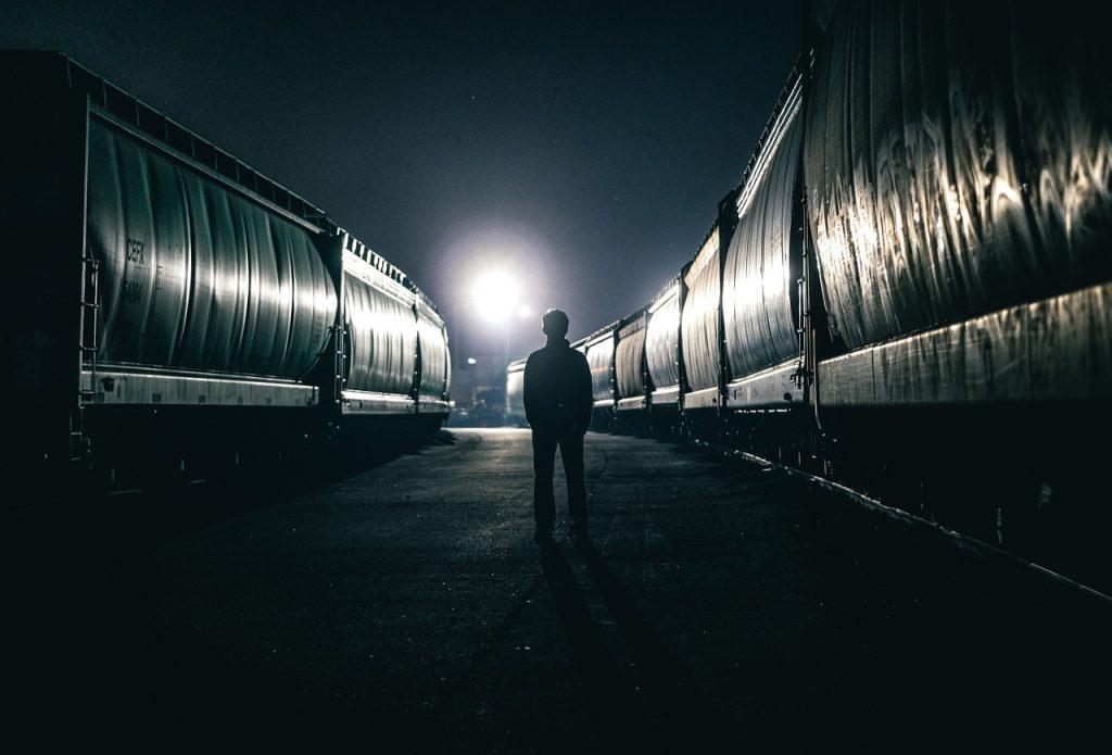 man standing in dark