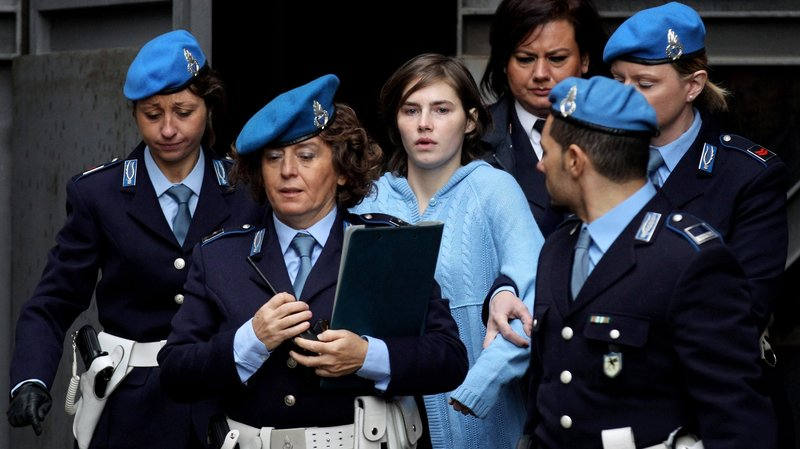 Amanda Knox, being lead to Court of Appeal in Perugia.