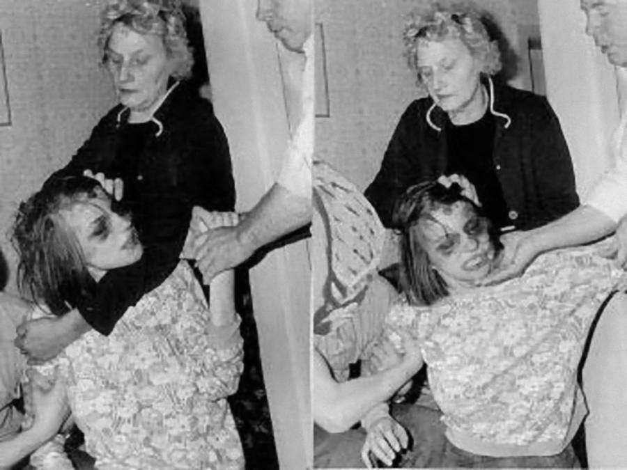 Anneliese being held by her mother during her exorcism