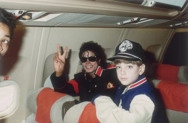 "Michael Jackson with 10 year old James ""Jimmy"" Safechuck on the tour plane"