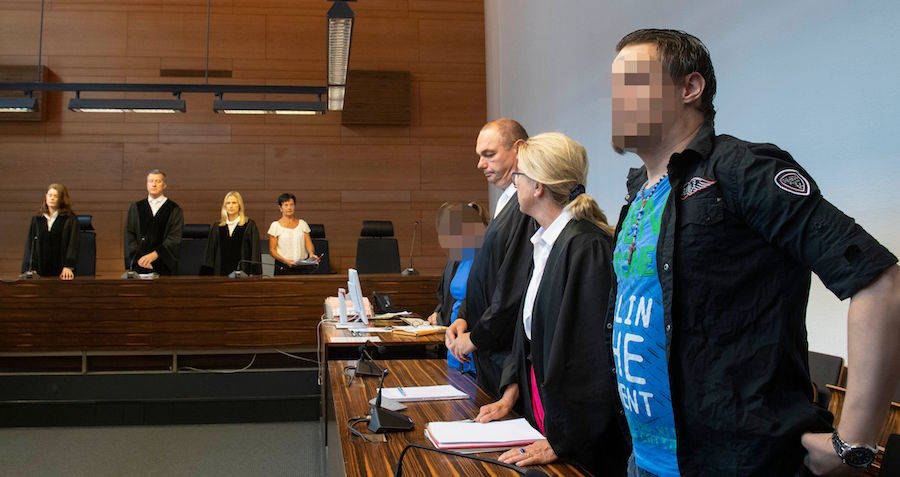 The defendants, Christian L (right) and Berrin T (fourth from right), face sentencing in Freiburg, Germany on Aug. 7.