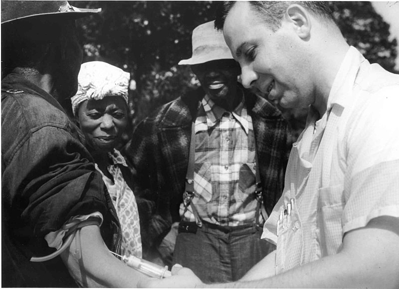 A doctor draws blood from one of the Tuskegee test subjects
