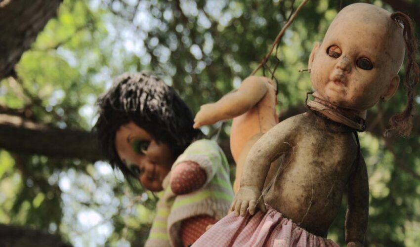 creepy images of haunted island of the dolls