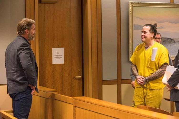 Joel Fulton(left) smiles at this brother Jason Vukovich during Vukovich's sentencing hearing